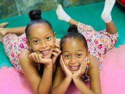 two-girls-laying-smiling-1600